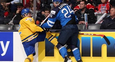 TORONTO, CANADA - JANUARY 2: Sweden's Sebastian Aho #2 takes a hit from Finland's Kasperi Kapanen #24 during quarterfinal round action at the 2015 IIHF World Junior Championship. (Photo by Andre Ringuette/HHOF-IIHF Images)