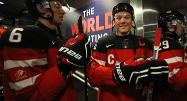 TORONTO, CANADA - JANUARY 2: Canada's Curtis Lazar #26, Shea Theodore #6 and teammates get set to take on Denmark during quarterfinal round action at the 2015 IIHF World Junior Championship. (Photo by Andre Ringuette/HHOF-IIHF Images)